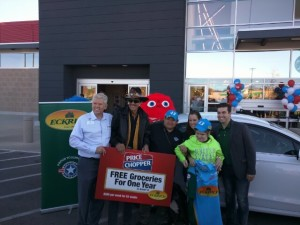 David Ball, CEO of Ball's Food Stores and Richard Petty present the Dizmang-Espy groceries for a year and a new 2016 Ford Fusion.