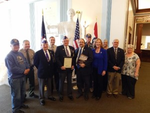 Clay County Missouri Commissioner pictured with veterans in attendance at the meeting and on staff in the Clay County government offices.